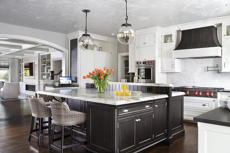 White And Gray Kitchen With Gold Pendants And Dip Dyed