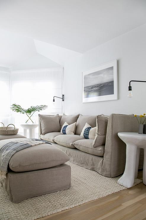 gray slipcovered sofa with gray pillow