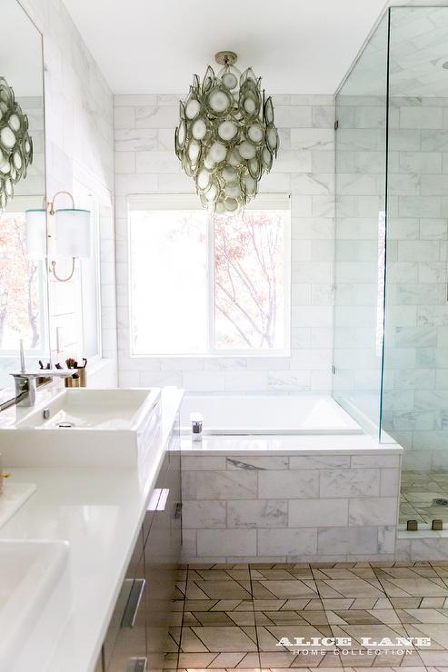 Gray Chandelier Over Marble Subway Tiled Bathtub Transitional Bathroom