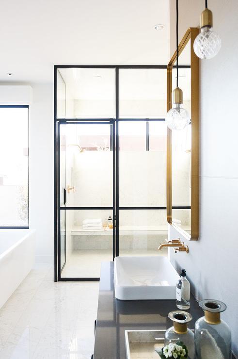 staggered bulb lights over bath vanity