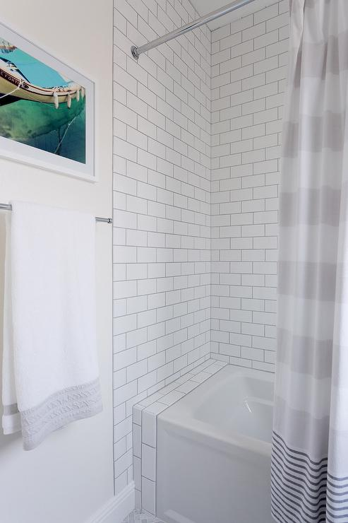 white subway tiled walls in shower and