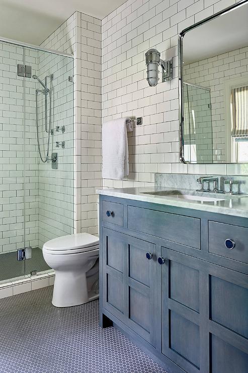 gray penny tile bath floor with blue