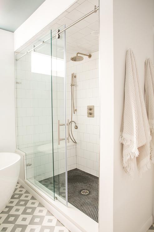 black hex tile shower floor with white
