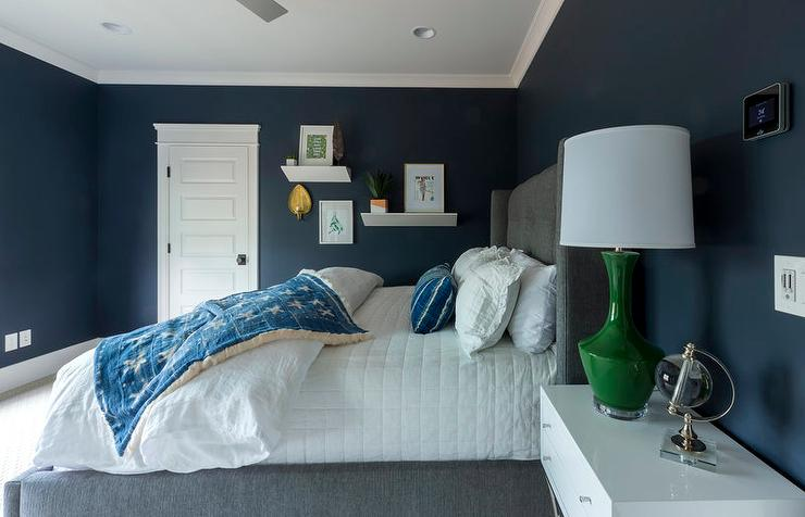 Dark Blue Bedroom Walls With Charcoal Gray Wingback Bed Transitional Boy S Room
