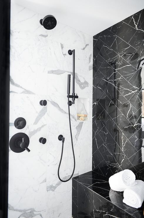 black marble herringbone pattern shower