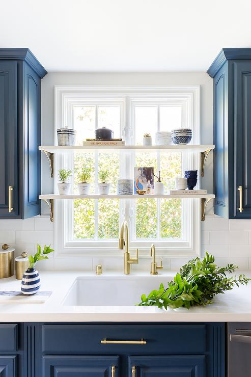 blue kitchen cabinets with white subway