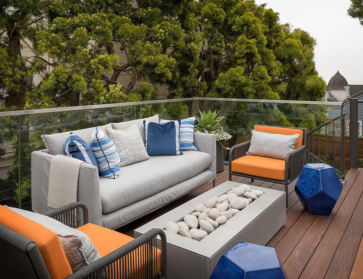 gray outdoor sofa with orange outdoor