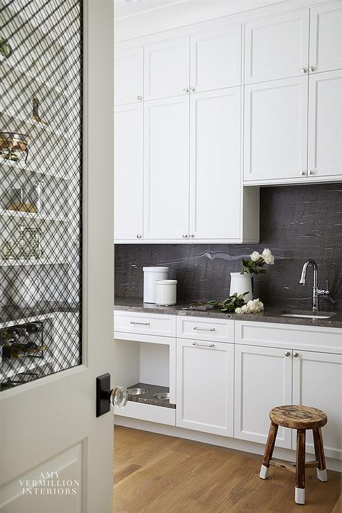 Stacked Kitchen Pantry Cabinets With Black Stone Slab Backsplash Transitional Kitchen