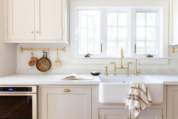 light gray shaker cabinetry with white