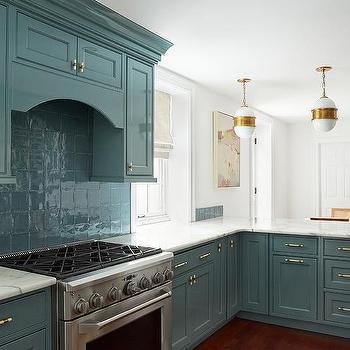 white kitchen with green backsplash