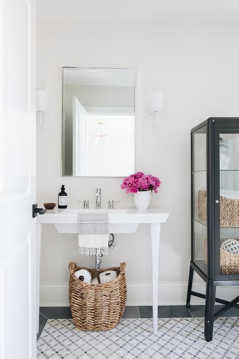 white modern pedestal vanity with black