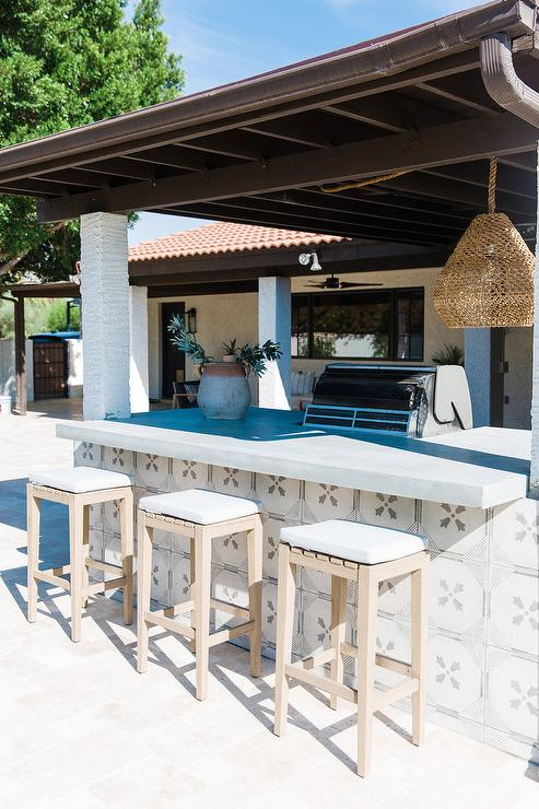 gray cement tiles on outdoor kitchen