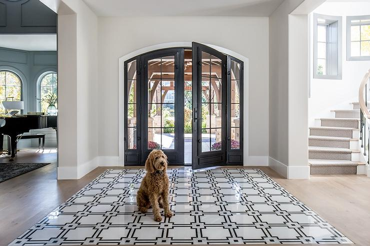 foyer with black and white accent tiles