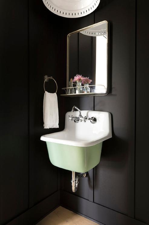 pale green vintage sink vanity on black