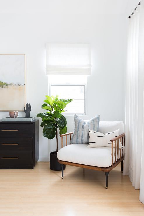 black dresser with long gold pulls
