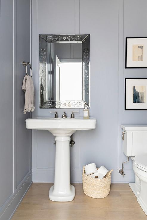 blue wall over pedestal sink