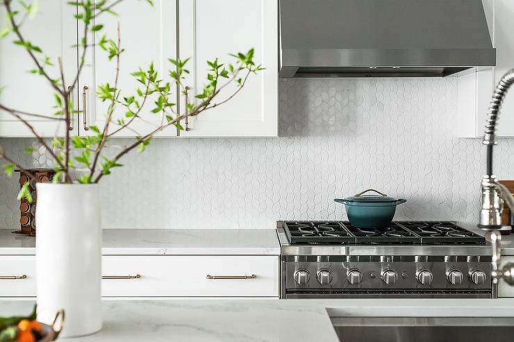 white leaf pattern kitchen backsplash