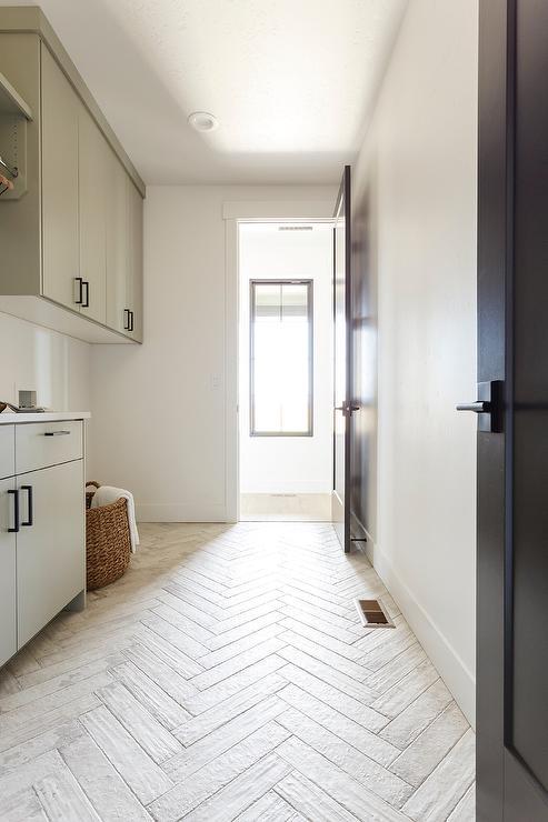 whitewashed herringbone tiles in
