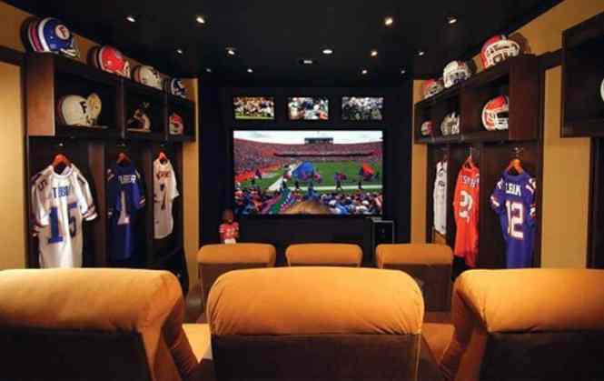 This Movie Room Is Decked Out With Football Team Decor Such As Helmets Sports Memorabilia And Jerseys E For Six To In One Of The