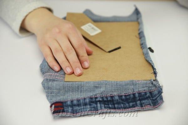 Fitting pocket onto frame back for a pen pocket