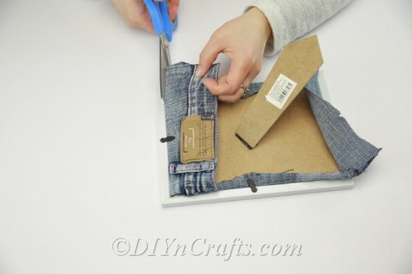 Fitting pocket inside a picture frame