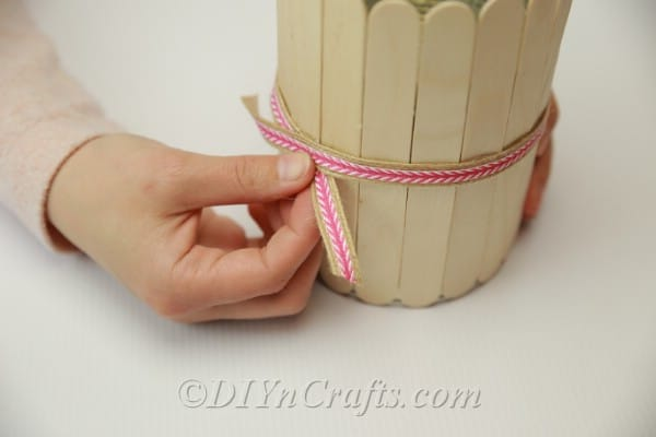Adding ribbon to the outside of popsicle stick pencil holder