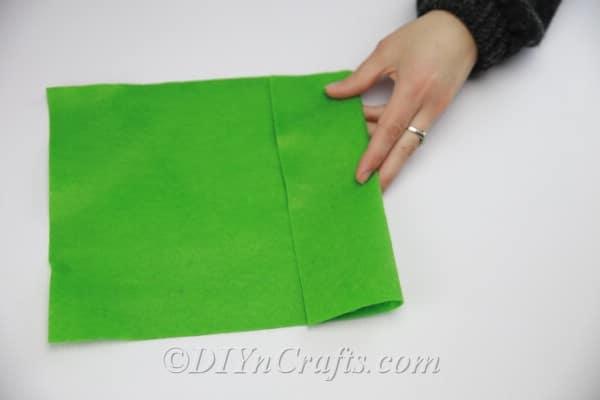Using green felt to create leaves