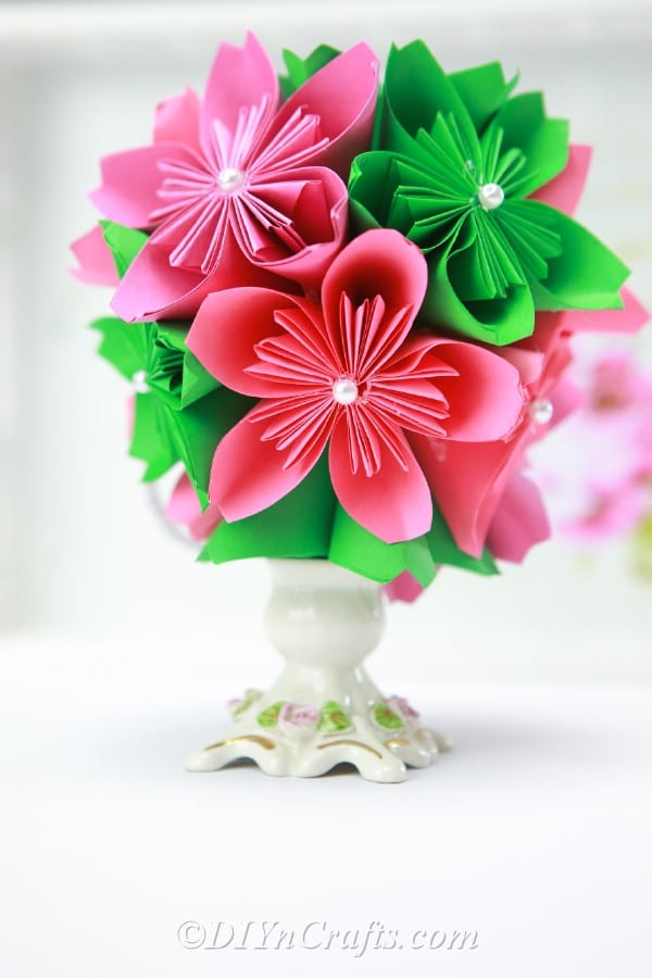 Close up image of a paper ball flower in a vase