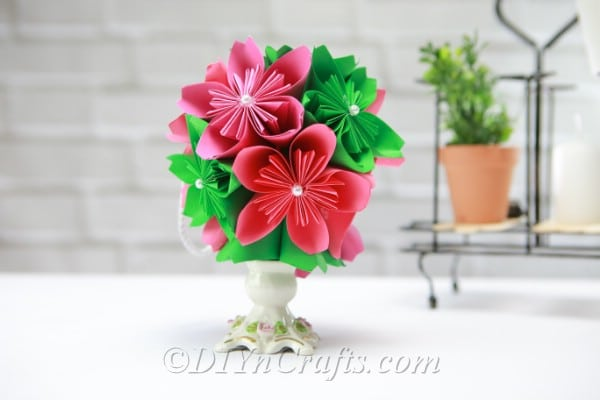 Pink and green paper flower ball in a vase