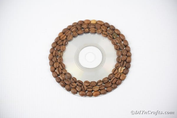 Gluing coffee beans onto CD