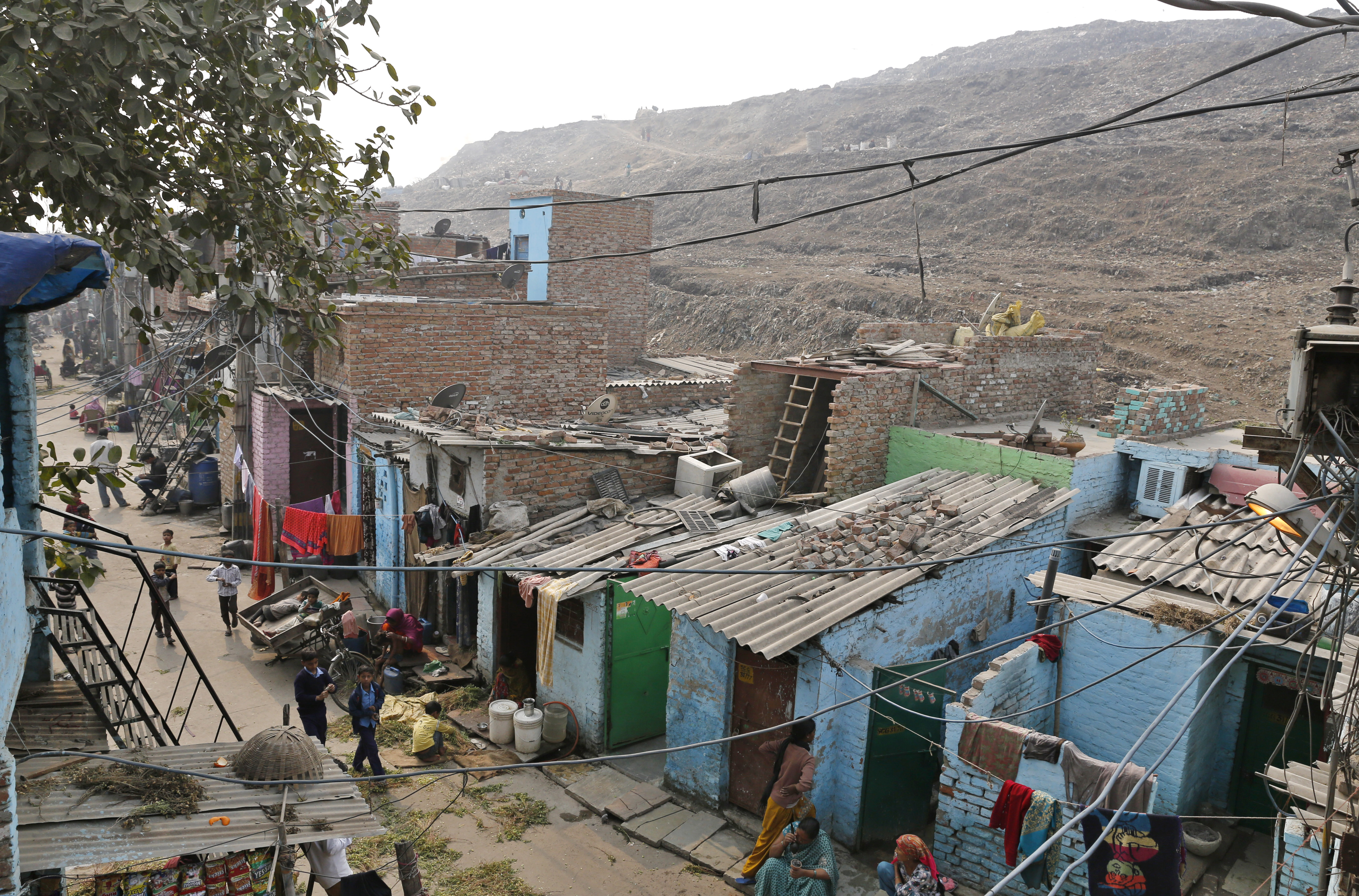 Government schemes envisage the development of land occupied by slums by shifting the residents into compact high-rise towers and freeing up most of the land for private commercial interest (Photo: Vikas Choudhary)