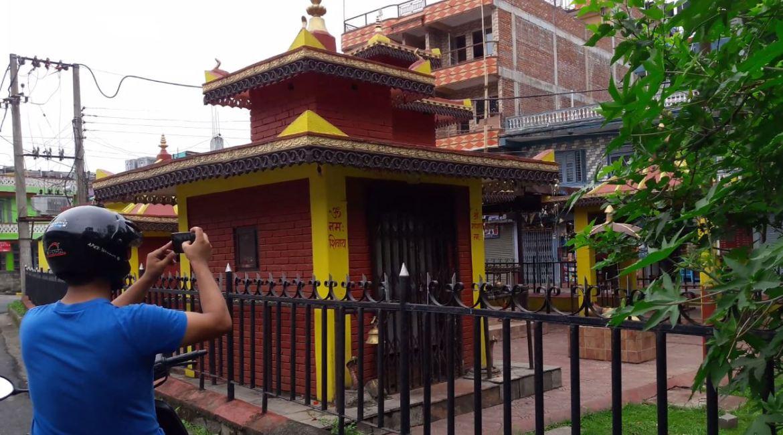Ekendra biking to take pics of temples for Google Maps