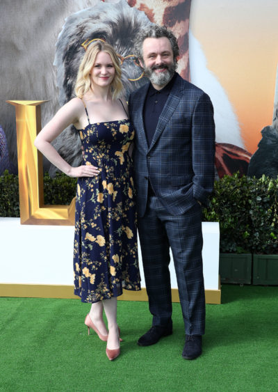 Michael Sheen smiles on the red carpet with girlfriend Anne Lundberg