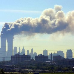 As seen from the New Jersey Turnpike near Kearny, N.J., smoke billows from the twin towers of the World Trade Center in New York after airplanes crashed into both towers Tuesday, Sept.11, 2001. (AP Photo/Gene Boyars)