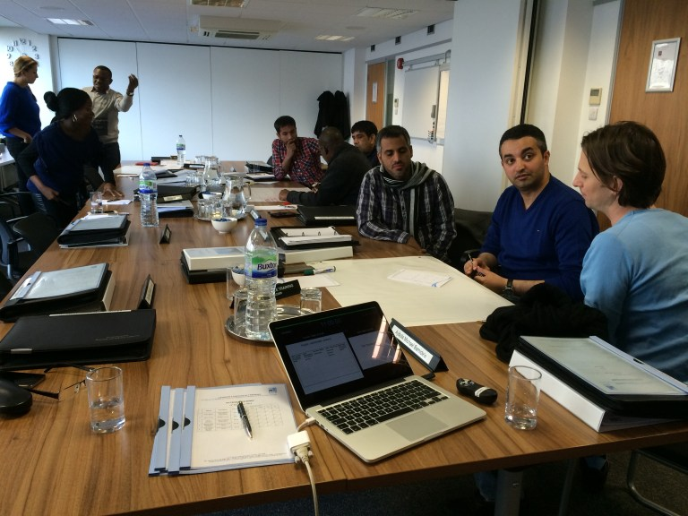 Participants discussing a case during a training session in London