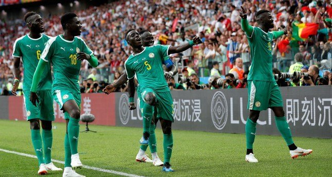 Senegal team celebrating a goal at the 2018 World Cup
