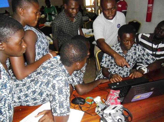 Dr. Ollennu explaining robotics science engineering techniques to schoolchildren in Ghana