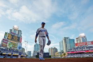 Jun 21, 2014; San Diego, CA, USA; Los Angeles Dodgers starting pitcher Josh Beckett (61) walks to the dugout before a game against the San Diego Padres at Petco Park. Mandatory Credit: Jake Roth-USA TODAY Sports