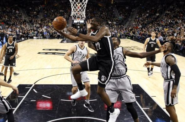 Dec 10, 2016; San Antonio, TX, USA; Brooklyn Nets shooting guard Caris LeVert (22) shoots the ball past San Antonio Spurs center Dewayne Dedmon (3, right) during the first half at AT&T Center. Mandatory Credit: Soobum Im-USA TODAY Sports
