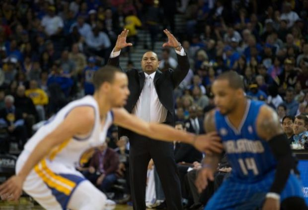 Mar 18, 2014; Oakland, CA, USA; Golden State Warriors head coach Mark Jackson gestures as guard Stephen Curry (30) defends Orlando Magic guard Jameer Nelson (14) during the second quarter at Oracle Arena. Mandatory Credit: Kelley L Cox-USA TODAY Sports