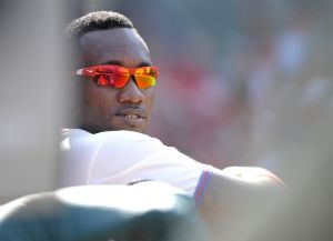 Sep 28, 2014; Philadelphia, PA, USA; Philadelphia Phillies left fielder Domonic Brown (9) watches from the dugout against the Atlanta Braves at Citizens Bank Park. The Braves defeated the Phillies, 2-1. Mandatory Credit: Eric Hartline-USA TODAY Sports