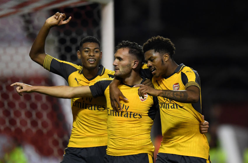 NOTTINGHAM, ENGLAND - SEPTEMBER 20: Lucas Perez (C) of Arsenal celebrates scoring his team's third goal with Jeff Reine-Adelaide (L) and Chuba Akpom of Arsenal during the EFL Cup Third Round match between Nottingham Forest and Arsenal at City Ground on September 20, 2016 in Nottingham, England. (Photo by Shaun Botterill/Getty Images)