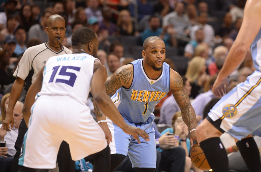 Mar 31, 2017; Charlotte, NC, USA; Denver Nuggets guard Jameer Nelson (1) looks to drive through the Charlotte Hornets defense during the first half of the game at the Spectrum Center. Mandatory Credit: Sam Sharpe-USA TODAY Sports