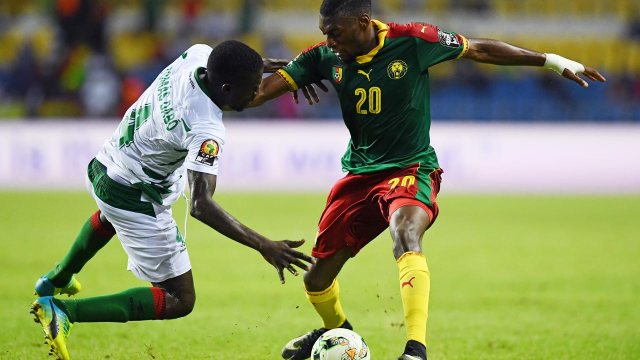 Cameroon's forward Karl Toko Ekambi (R) challenges Guinea-Bissau's defender Tomas Dabo during the 2017 Africa Cup of Nations group A football match between Cameroon and Guinea-Bissau at the Stade de l'Amitie Sino-Gabonaise in Libreville on January 18, 2017.  GABRIEL BOUYS / AFP