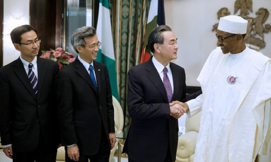China' foreign Affairs minister Wang Yi and President Muhammadu Buhari PHOTO: NAN