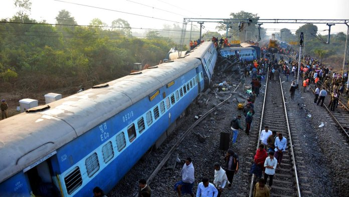 Rescue workers search for victims at the site of the derailment of the Jagdalpur-Bhubaneswar express train near Kuneru station in southern Andhra Pradesh state on January 22, 2017. Rescuers battled to pull survivors from the wreckage of a train crash which killed 32 passengers in southern India, the latest in a series of disasters on the country's creaking rail network. STRINGER / AFP