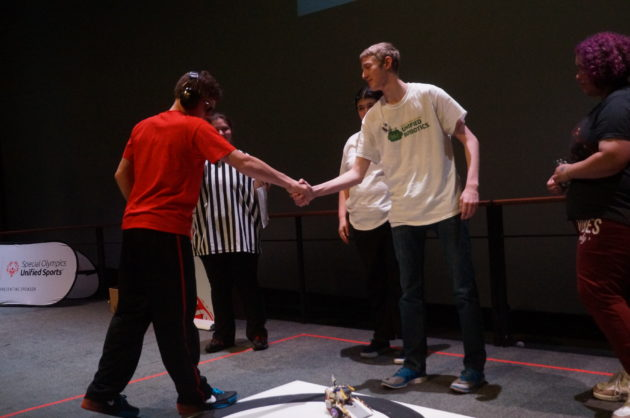 Finalists in the competition shake hands before the match begins. (GeekWire Photo / Clare McGrane)