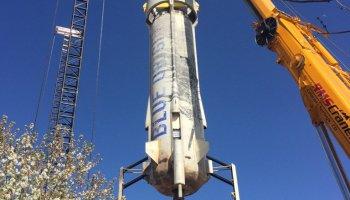 Blue Origin New Shepard booster on crane