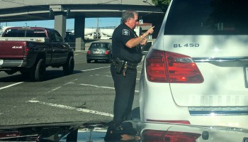 We rode along with Seattle PD to see how cops are busting drivers violating new distracted driving law