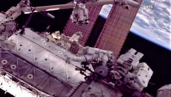 Spacewalkers put new hand on robot arm